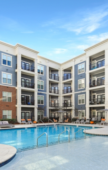 4-story modern apartment buildings surrounding a pool